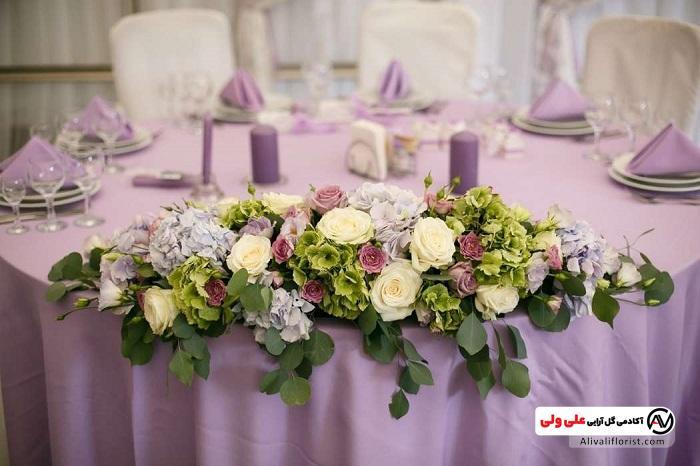 گل آرایی روی میز پذیرایی