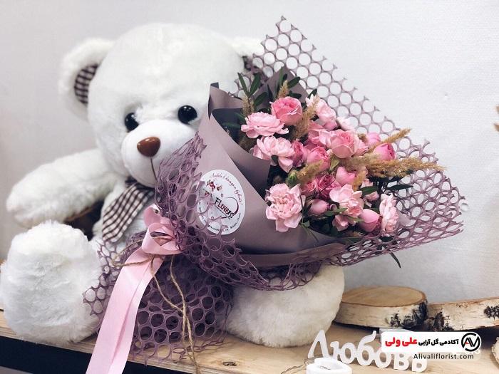 دسته گل با عروسک برای تولد نوزاد